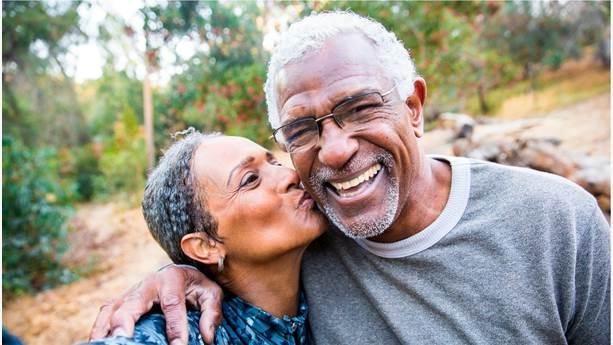 Senior couple taking selfie while exercising